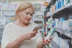 Lovely senior woman shopping at drugstore stock images
