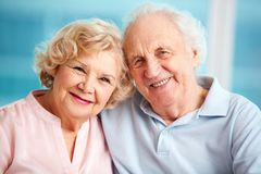 Lovely seniors. Portrait of charming seniors enjoying spending time together stock image