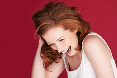 Lovely Sense Of Humour. Attractive redhead woman having a good laugh and showing a lovely sense of humour royalty free stock photos