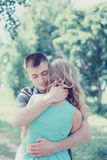 Lovely sensual couple in love, man embracing woman, warm feeling Royalty Free Stock Images