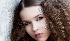 Lovely sensual woman face. Curly hair. Beauty eyes Royalty Free Stock Image