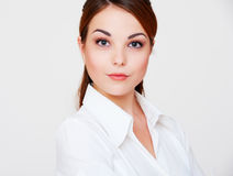 Lovely serious woman in white shirt Stock Photos