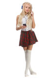 Lovely sexy blonde girl in checkered short skirt with headphones Stock Image