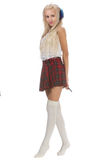 Lovely sexy blonde girl in checkered short skirt with headphones Royalty Free Stock Photography