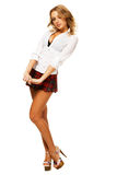 Lovely sexy girl in checkered short skirt. On white background Stock Photos