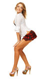 Lovely sexy girl in checkered short skirt Royalty Free Stock Images