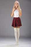 Lovely sexy girl in checkered short skirt Stock Images