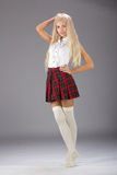 Lovely sexy girl in checkered short skirt Royalty Free Stock Image