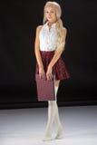 Lovely sexy girl in plaid short skirt Stock Image