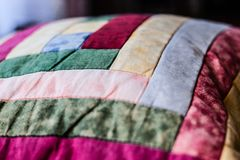 Lovely shot of pillow created by patchwork technique. Pillow from my Grandma.  Royalty Free Stock Photo