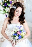 Lovely shy girl in a wedding dres royalty free stock photos