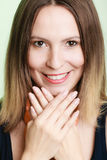 Lovely shy woman lauging. Smiling girl embarrassed covers her face with palms Stock Photography