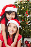 Lovely sibling with Christmas outfit Stock Photo