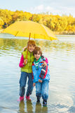 Lovely siblings under umbrella Stock Photo