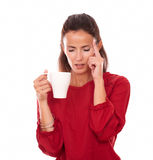 Lovely single lady with headache holding a cup Stock Photo