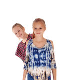 Lovely sisters standing behind each other. Stock Photography