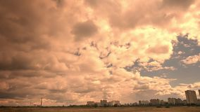 Lovely skies shooting, city view far away on background, darkening sky and sunshines showing up, outside illustration