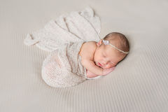 Lovely sleeping infant wrapped in gray warm diaper. Lovely smiling sleeping infant wrapped in gray warm diaper Stock Photos