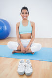 Lovely slender woman sitting in lotus position Stock Image