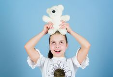 Lovely small girl smiling happy face with favorite toy. Best friends. Imaginary friend. Little girl play with soft toy royalty free stock image