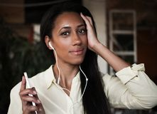 Lovely smile by beautiful black woman music fan, lifestyle conce. Pt, indoor, cafe or home Stock Photography