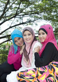 Lovely smile from muslim girls. At park royalty free stock photo