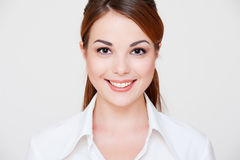 Lovely smiley woman in white shirt Stock Image