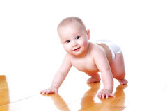 Lovely smiling baby 6 month old in diaper Royalty Free Stock Images