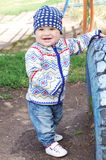 Lovely smiling baby outdoors. Lovely smiling baby age of 10 months outdoors Stock Photo