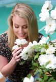 Lovely Smiling Blond Lady and Flowers Royalty Free Stock Images