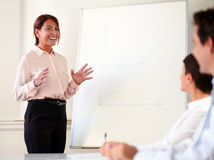 Lovely smiling businesswoman giving a presentation Stock Image