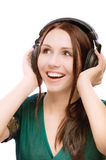 Lovely smiling girl in ear-phones Royalty Free Stock Images