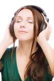 Lovely smiling girl in ear-phones Royalty Free Stock Photo
