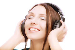 Lovely smiling girl in ear-phones Royalty Free Stock Photography
