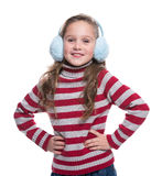 Lovely smiling little girl wearing colorful striped sweater and headdress isolated on white background. Winter clothes. Lovely smiling little girl wearing Stock Image
