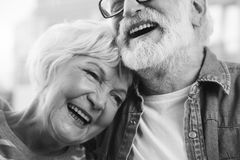 Lovely smiling old couple hugging each other. Sincere emotions. Close up black-and-white portrait of mature married men and women bonding to each other while royalty free stock photography