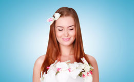 Lovely smiling woman with flower petals on the body Stock Images
