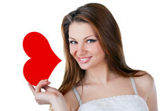 Lovely smiling woman holding a heart Royalty Free Stock Photography