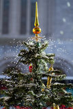 Lovely snowing christmas tree Royalty Free Stock Photo