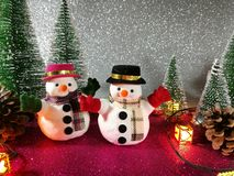 Lovely Snowman pink gliter background near ornament lighting bulb at silent night, holy night, Merry Christmas and hap royalty free stock photos