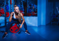 Lovely sports woman in gym Stock Photo