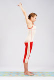 Lovely sporty woman doing stretching exercise Royalty Free Stock Image