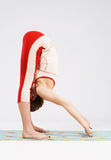 Lovely sporty woman doing stretching exercise Royalty Free Stock Images