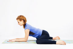 Lovely sporty woman doing stretching exercise Stock Images