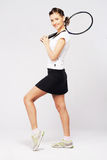 Lovely sporty woman with tennis racket royalty free stock photo
