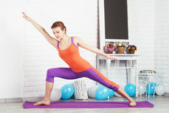 Lovely sporty woman is working out Royalty Free Stock Image