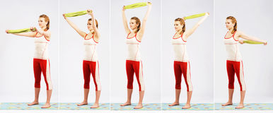 Lovely sporty woman is working out. Elements of stretching exerc Stock Photo