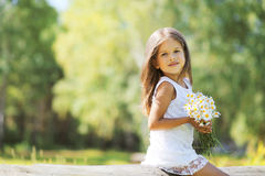 Lovely spring girl with flowers. Nature in sunny day Royalty Free Stock Photography