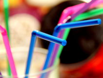 Lovely straws. Funny juice straws in different colors -all in glass Stock Images