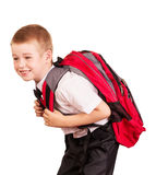 Lovely student with  heavy backpack isolated on white background. Lovely student with a heavy backpack isolated on white background Royalty Free Stock Images